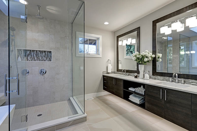 Spacious bathroom in gray tones with heated floors, walk-in shower, double sink vanity and skylights. Northwest, USA